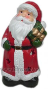 Керамична фигура на Дядо Коледа със свещ